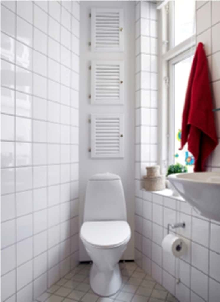White small bathroom with toilet at the corner for Corner tub decorating ideas