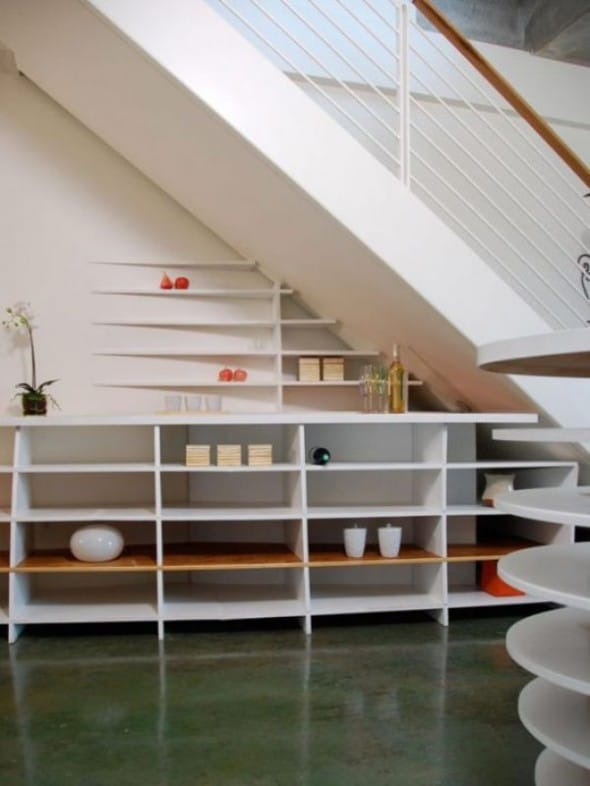 artful and useful shelves under the stair way