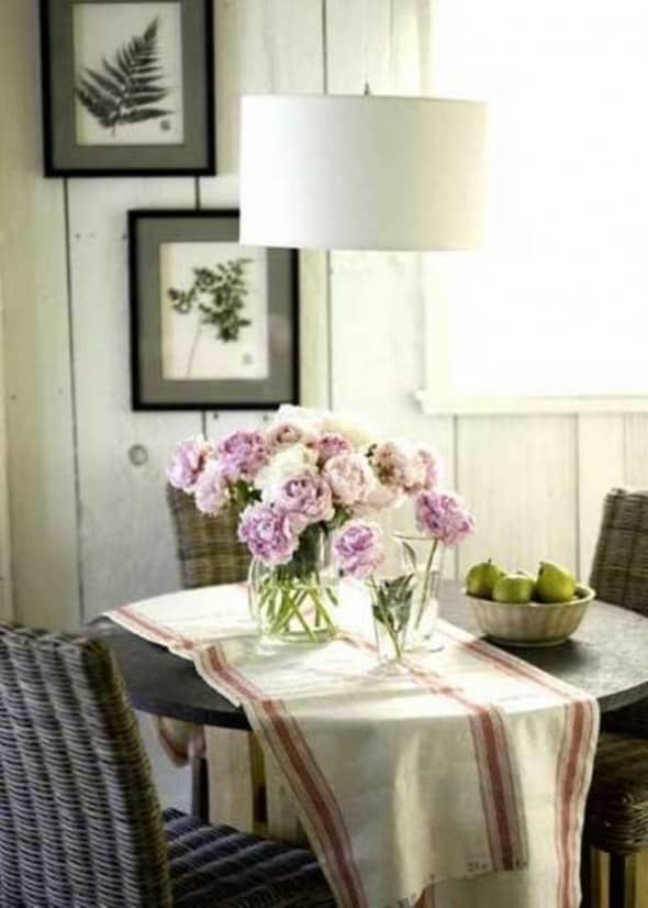 cottage style dining room with rattan chair