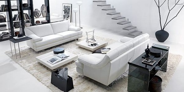 white living room wit black furniture which stand out