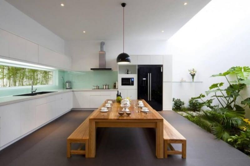 Green Glass Backsplash Matches the Plants - Sophisticated Modern Penthouse Design